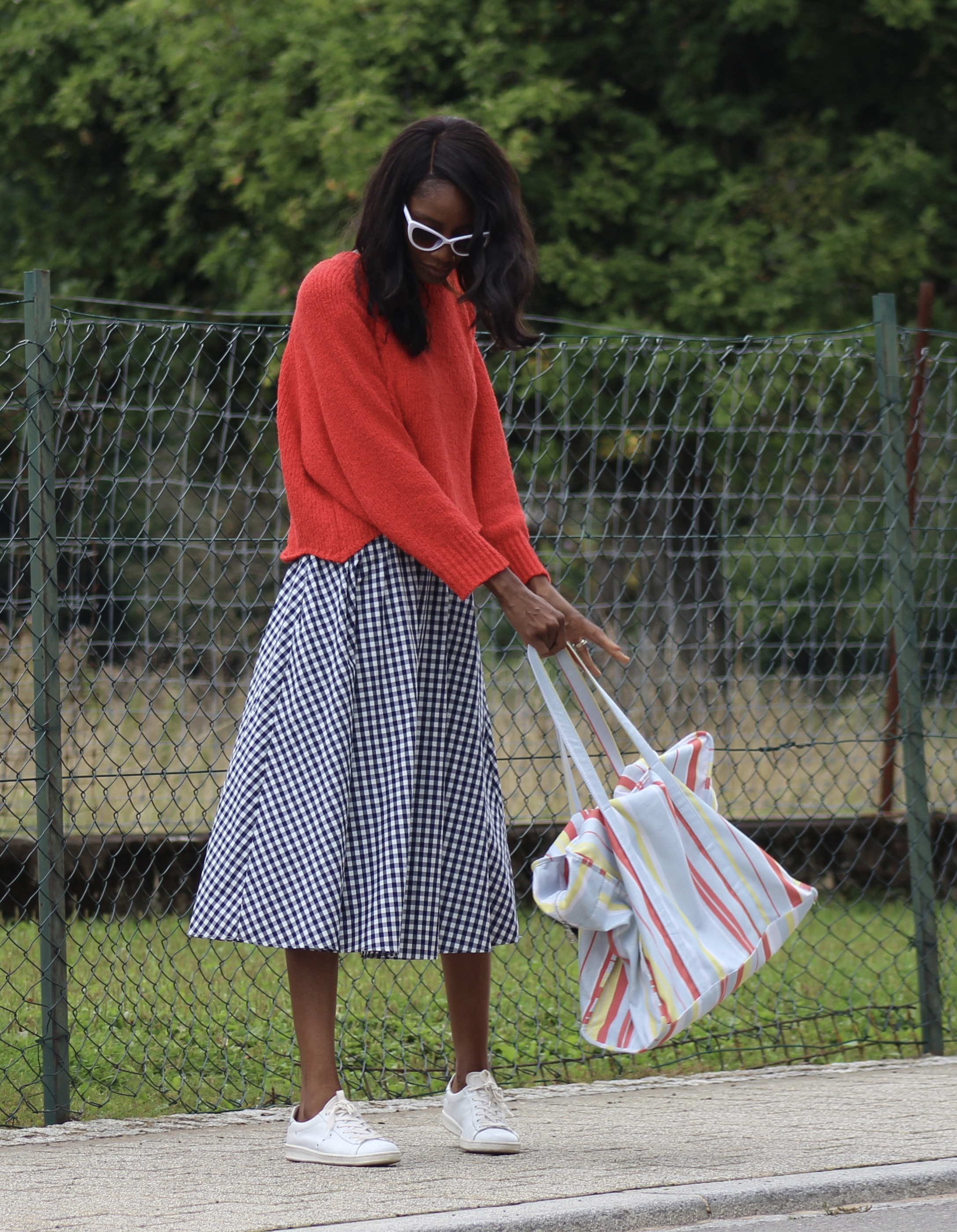 gingham skirt red jumper white sneakers tote bag
