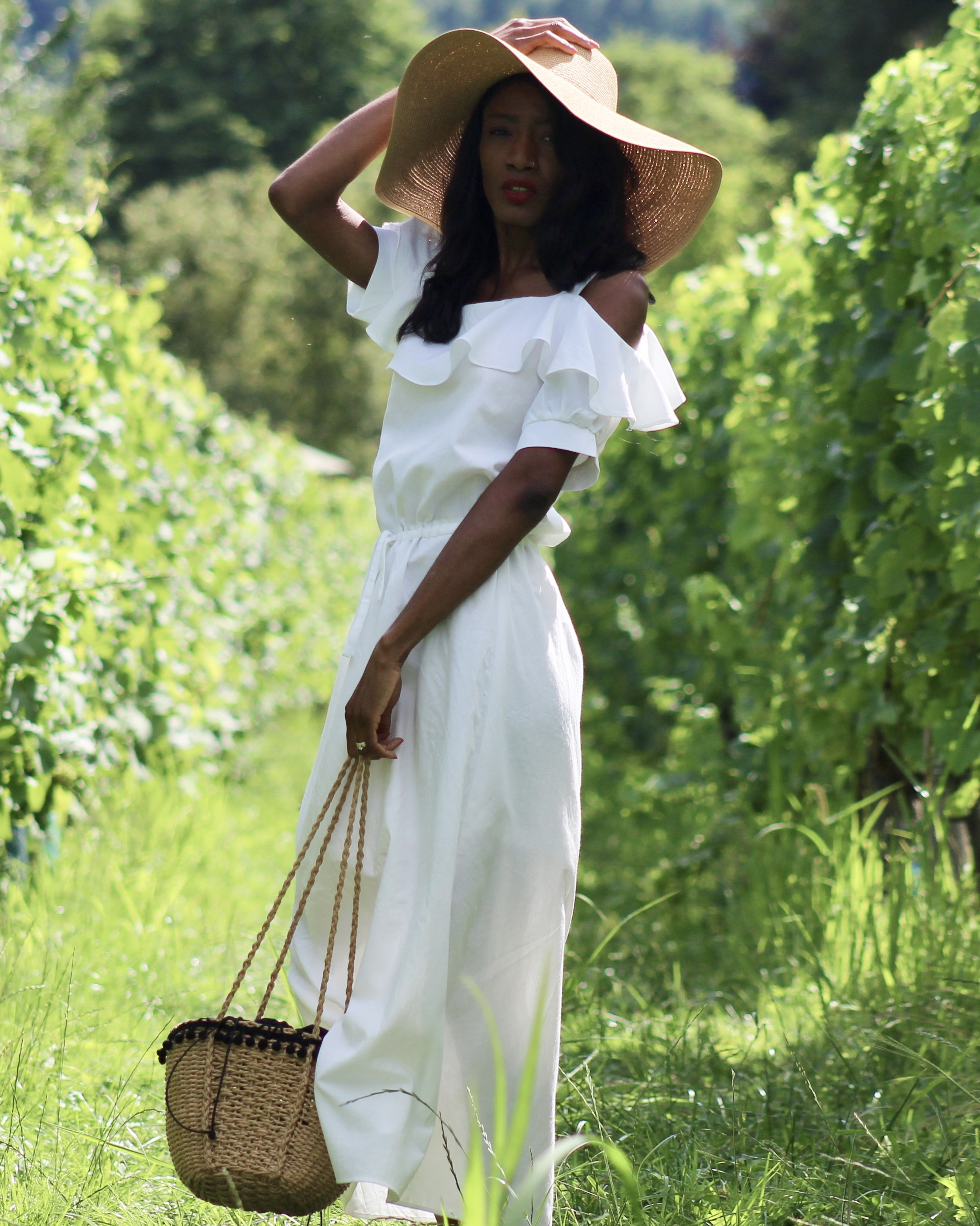 white summer dress floppy hat sandals