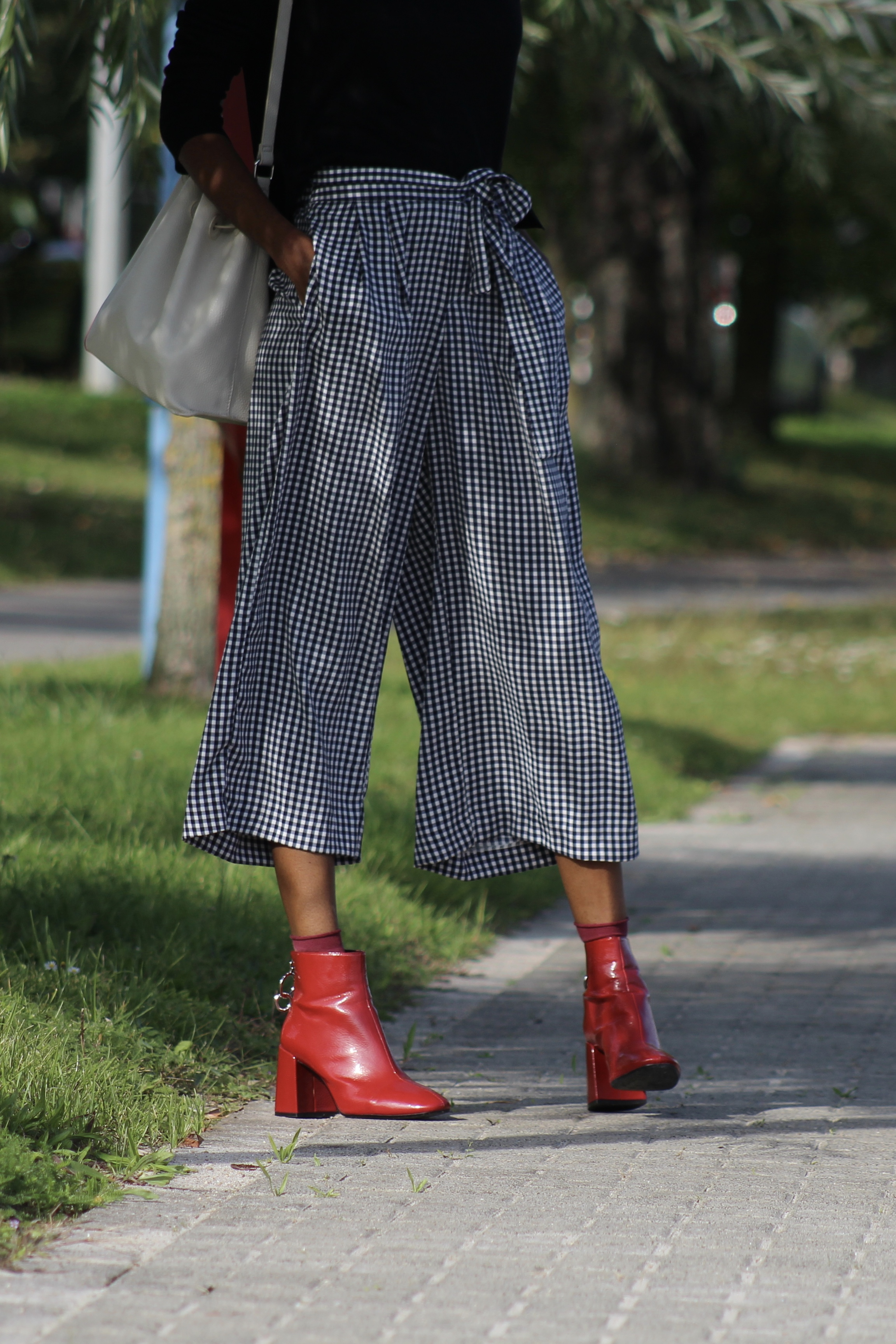 denim jacket gingham trousers red boots